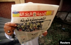 A man reads the Muslim Brotherhood's newspaper Al-Hurriya wa-l-adala (Freedom of Justice), named after their political party in Cairo, Sept. 3, 2013.
