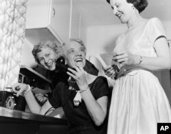 Sen. Margaret Chase Smith makes calls to friends from her home in Skohegan, Maine in this June 21, 1954 file photo. (AP)