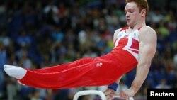 Vận động viên Anh Sam Oldham trong cuộc tranh tài môn thể dục dụng cụ nam tại Olympic hôm 30/7/12