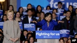 Democratic presidential candidate Hillary Clinton, left, is welcomed by Rep. Judy Chu, D-Calif., before addressing Asian American and Pacific Islander supporters in San Gabriel, Calif., Thursday, Jan. 7, 2016.