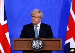 FILE - Britain's Prime Minister Boris Johnson, listens to a question from the media during a press conference about the ongoing coronavirus outbreak, in London, May 14, 2021.