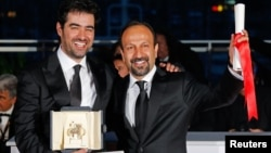 Director Asghar Farhadi (R), Best screenplay award winner and Actor Shahab Hosseini,