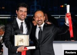 Director Asghar Farhadi and actor Shahab Hosseini after their Cannes wins.