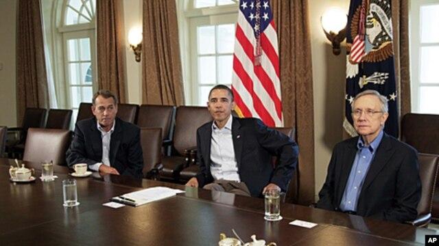 President Barack Obama meets with Senate Majority Leader Harry Reid, right, and House Speaker John Boehner, left, in the Cabinet Room of the White House, July 23, 2011
