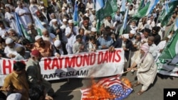 Supporters of the religious and political party Jamaat-e-Islami burn the U.S flag during a protest rally against American Raymond Davis in Karachi, February 11, 2011.