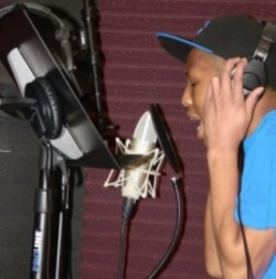 Yung Fresh in the studio, recording his own songs