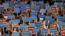 Delegates hold up signs during Maryland Gov. Martin O'Malley speech at the Democratic National Convention in Charlotte, N.C., on Tuesday, Sept. 4, 2012.