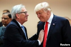 U.S. President Donald Trump, right, talks with European Commission President Jean-Claude Juncker, left, before a working session at the G-20 summit in Hamburg, Germany, July 8, 2017.