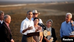 U.S. President Barack Obama speaks during a visit to a drought affected farm in California on Feb. 14, 2014.