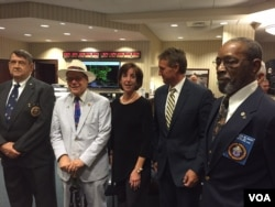 Far left and right: former Marines who were in Havana to lower flag 54 years ago and who will help raise it today. Also pictured: Assistant Secretary of State for Western Hemisphere Affairs Roberta Jacobson, Tennessee Congressman Steve Cohen and Arizona Senator Jeff Flake. (Photo: Pam Dockins / VOA)