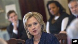 Secretary of State Hillary Rodham Clinton gestures during a meeting of the President's Interagency Task Force on human trafficking, Tuesday, Feb. 1, 2011, at the State Department in Washington.
