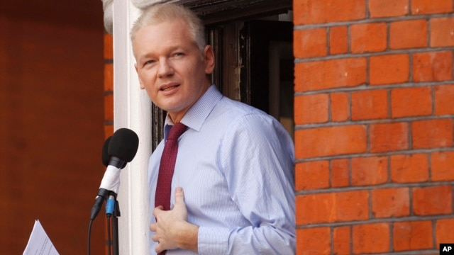 WikiLeaks founder Julian Assange makes a statement to the media and supporters at a window of Ecuadorian Embassy in central London, Aug. 19, 2012