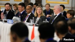 U.S. Under Secretary of State Andrea Thompson, center, delivers her opening remarks during a Treaty on the Non-Proliferation of Nuclear Weapons conference in Beijing of the U.N. Security Council's five permanent members China, France, Russia, the United