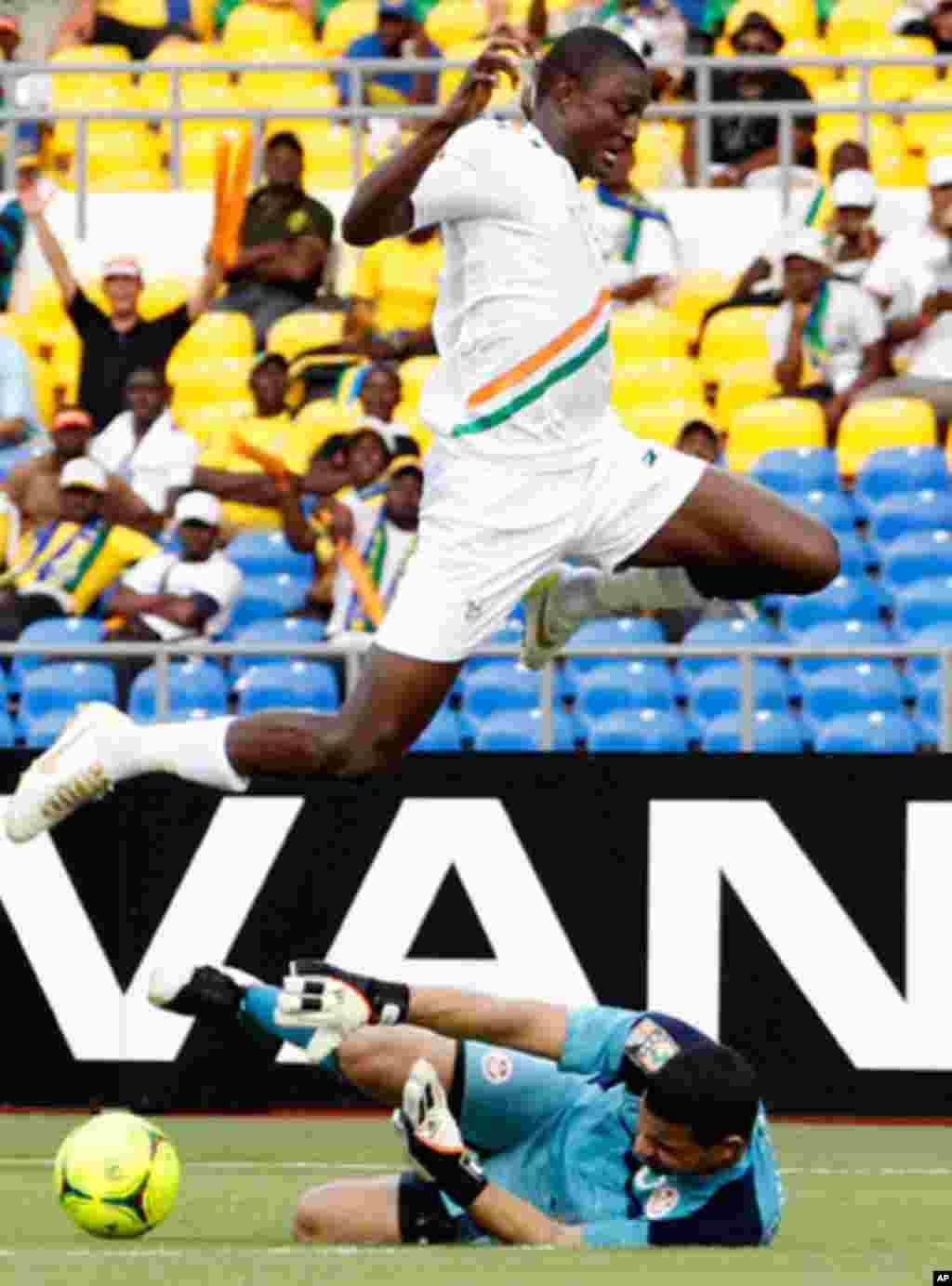 Niger's Moussa jumps over Tunisia's Ayem during their African Cup of Nations soccer match in Libreville