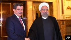 حسن روحانی رئیس جمهوری اسلامی ایران و احمد داووداوغلو نخست وزیر ترکیه در تهران