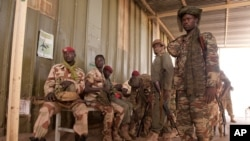 FILE - In this picture provided by the French Army Communications Audiovisual office (ECPAD), Chad soldiers for the African-led international support mission to Mali wait to board an aircraft in N'Djamena, Chad, bound for Bamako, the capital of Mali, Jan.