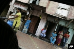FILE - Sex workers are seen at a red-light area in Mumbai, India, Aug. 4, 2009.