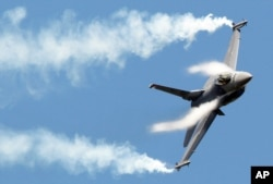 FILE - F16 fighter jet takes part in a flying display during the 49th Paris Air Show.