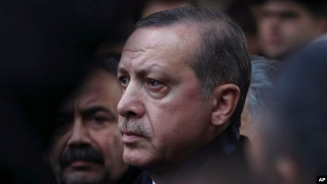 Turkish Prime Minister Recep Tayyip Erdogan at funeral for Serafettin Elci, a prominent Turkish Kurdish politician and former minister, Ankara, Dec. 26, 2012.