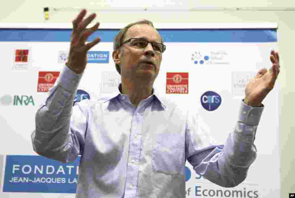 French economist and Nobel Prize laureate Jean Tirole addresses the media during a press conference at the Toulouse School of Economics in Toulouse, southern France, Oct. 13, 2014.