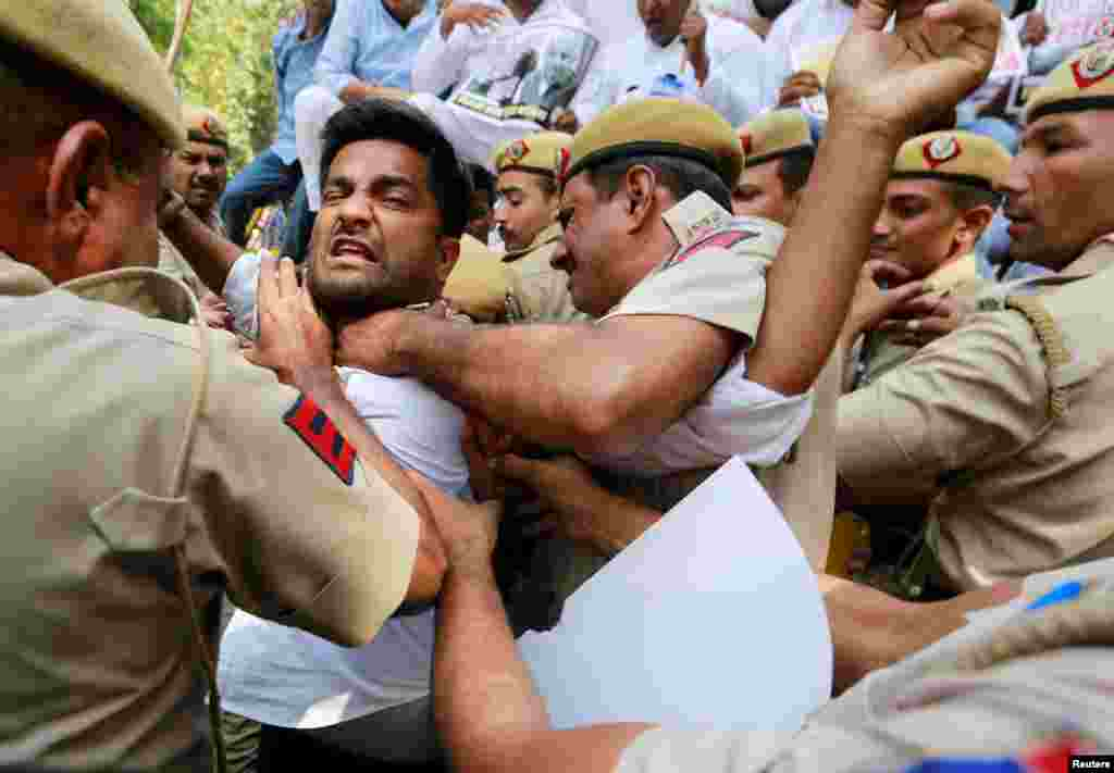 Supporters of India's main opposition Congress party scuffle with police during a protest demanding the resignation of India's Minister of State for External Affairs Mobashar Jawed Akbar in New Delhi.
