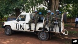 "United Nations Peacekeepers drive through Yei, South Sudan, July 13, 2017. The United Nations peacekeeping mission's chief says Yei has ""gone through a nightmare."" Since fighting spread to the city a year ago, 70 percent of the population has fled."