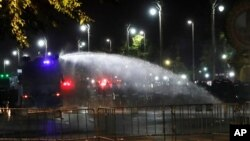 Police use water cannons to disperse protesters Saturday, March 20, 2021 in Bangkok, Thailand. Thailand's student-led pro-democracy movement is holding a rally in the Thai capital, seeking to press demands that include freedom for their leaders, who…
