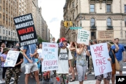 FILE - People gather to protest recent mandates requiring vaccines against the coronavirus, in New York's Central Park, Aug. 21, 2021.