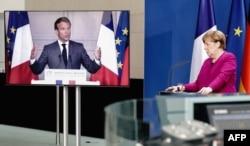 앙겔라 메르켈 독일 총리가 18일 독일 베를린에서 에마뉘엘 마크롱 프랑스 대통령과 공동 영상기자회견을 하고 있다.