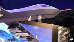 FILE - A model of the Wing Loong II weaponized drone is displayed at a stand for the China National Aero-Technology Import & Export Corp., at a military drone expo in Abu Dhabi, United Arab Emirates, Feb. 25, 2018.