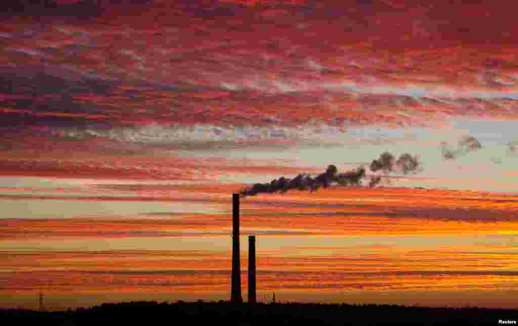Smoke rises from the chimney stalk of a gas-fired power station after sunset on the outskirts of Minsk, Belarus.