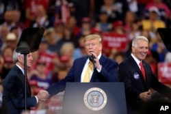 FILE - President Donald Trump speaks at campaign rally in Lake Charles, La., Oct. 11, 2019.