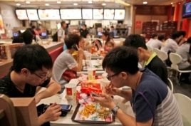 Customers eat at a McDonald's restaurant in Hong Kong on July 25, 2014.