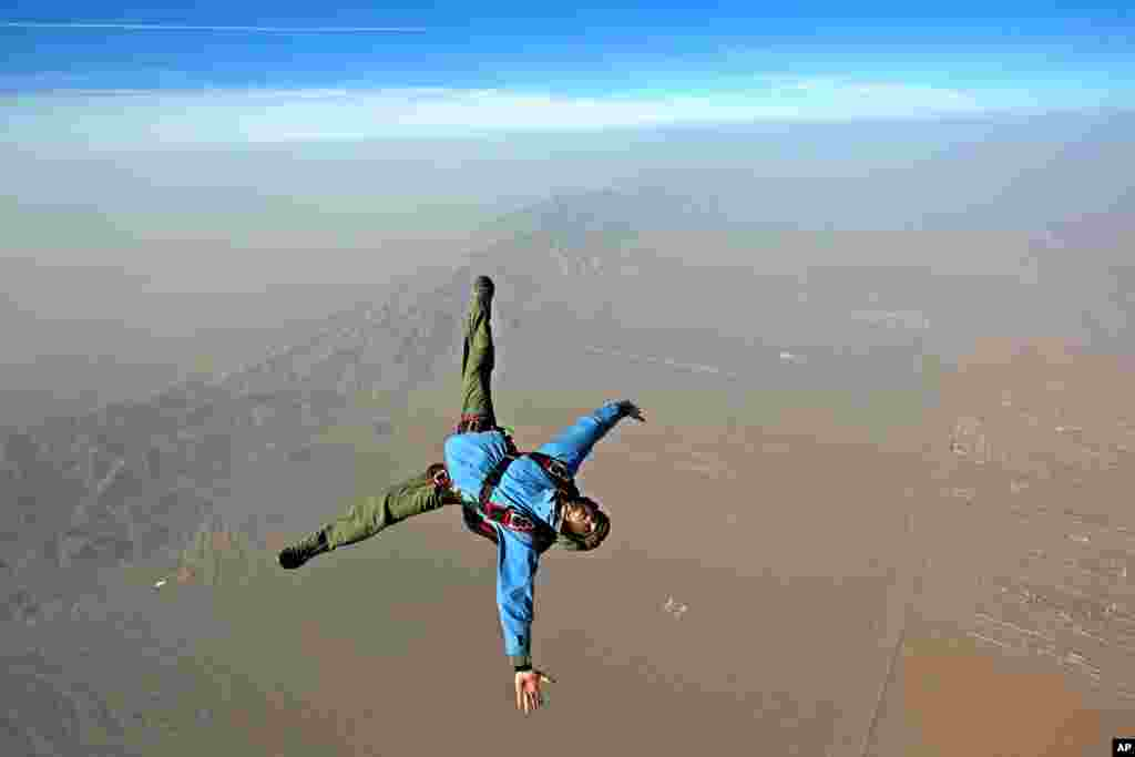 An Iranian skydiver jumps from a helicopter outside Tehran.