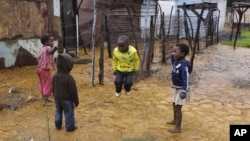 Children jump rope at the Tudor Shaft squatter settlement near Randfontein, west of Johannesburg, South Africa, January 26, 2011.