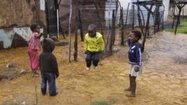 Children jump rope at the Tudor Shaft squatter settlement near Randfontein, west of Johannesburg, South Africa, January 26, 2011.