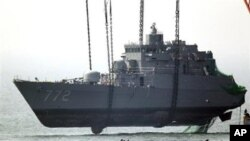 Salvaging the bow section of the South Korean naval ship Cheonan. Evidence indicates a torpedo launched from a small North Korean submarine hit the Cheonan on March 26, 2010, killing 46 sailors. (AP Photo/Yonhap, Choi Jae-ku, File)