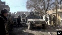 伊拉克政府军攻入拉马迪南部城区。(2015年12月23日)