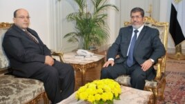 Egyptian President Mohamed Morsi (R) is seen with Prosecutor General Talaat Abdullah in a photo released by Morsi's office November 22, 2012.