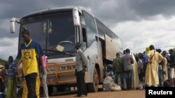 Malians who fled unrest in the northeastern city of Gao wait at a bus station in Bamako to return home, Sept. 3, 2012.