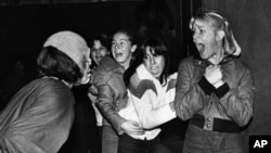 "This is a vintage American horror scene. Girls scream at a ""haunted mansion"" in suburban Sacramento, California, when a Halloween ""monster"" scares them, October 30, 1979. (AP Photo/RCP)"