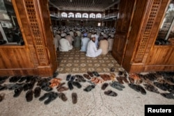 FILE - Students attend a lesson at Darul Uloom Haqqania, an Islamic seminary and alma mater of several Taliban leaders, in Akora Khattak, Khyber Pakhtunkhwa province, Sept. 14, 2013.