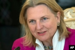 FILE - Austrian Foreign Minister Karin Kneissl speaks during a meeting in Moscow, Russia, April 20, 2018.
