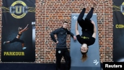 CUC director Lucas Dollfus poses next to student Zoe Simonnuti during a training session at France's Campus Univers Cascade (CUC), a training ground for stuntmen.REUTERS/Pascal Rossignol