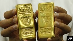 Gold bars are shown at the Korea Gold Exchange in Seoul, South Korea. Gold's allure stems in part from fears that the world's major economies are dangerously indebted, August 9, 2011