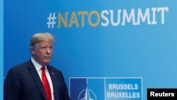 U.S. President Donald Trump attends the start of the NATO summit at the Alliance's headquarters in Brussels, Belgium