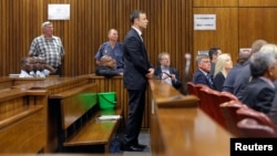 Olympic and Paralympic track star Oscar Pistorius stands in the dock at the North Gauteng High Court in Pretoria, September 11, 2014. Pistorius, the double amputee who became one of the biggest names in world athletics, faced justice on Thursday as a Sout