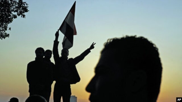 The sun sets on protesters as they demonstrate and celebrate in Tahrir Square in Cairo February 11, 2011