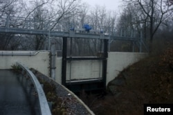 FILE - The sluice gate of the Boman Avenue Dam is pictured in Rye, New York, December 23, 2015. Iranian hackers breached the control system of a dam near New York City in 2013.