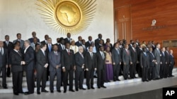 African heads of state, joined by Palestinian President Mahmoud Abbas, sixth from left in front row, and UN Secretary-General Ban ki-Moon, third from right in front row, pose for a group photograph at the annual African Union summit held at the AU headquarters in Addis Ababa, Ethiopia, Jan. 30, 2015.